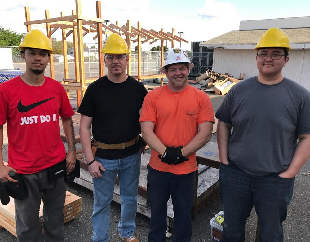 4 students wearing hard hats